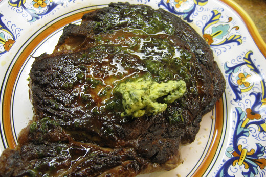 Grilled bone-in rib-eye steak with maitre d'hotel butter. Credit: Clifford A. Wright