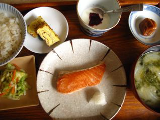 Japanese breakfast display of salmon, miso soup umeboshi